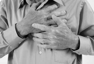 Man clutching his chest.