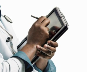 Doctor writing in an electronic notepad