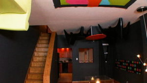 black-basement-with-furniture-on-ceiling